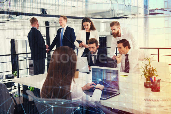 Businessperson in office connected on internet network. concept of partnership and teamwork Stock photo © alphaspirit