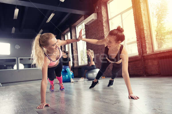 Two friend at the gym doing pushup Stock photo © alphaspirit