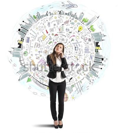 Businesswoman thinks business world Stock photo © alphaspirit