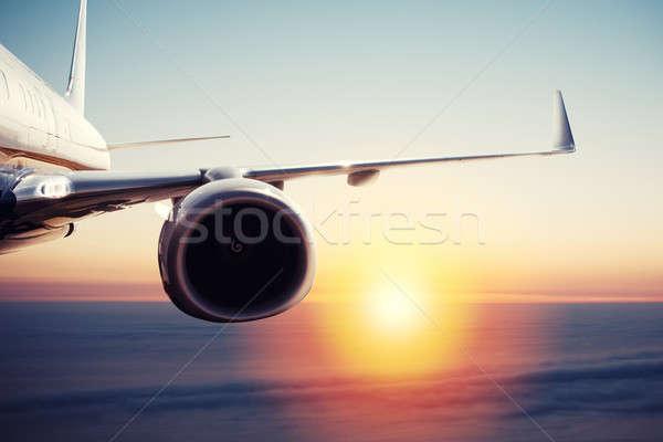 самолета полет облака Восход быстро небе Сток-фото © alphaspirit