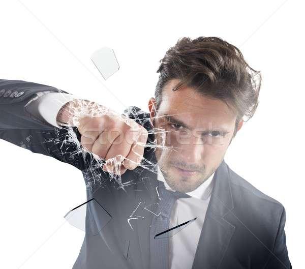 Fist of determinated businessman Stock photo © alphaspirit