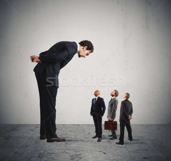 Severe boss humiliates his employees Stock photo © alphaspirit