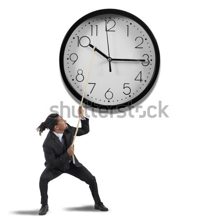 Move clock hands to change the time Stock photo © alphaspirit
