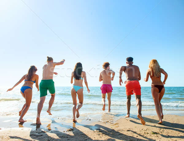 Group of friends run to the sea. Concept of summertime Stock photo © alphaspirit