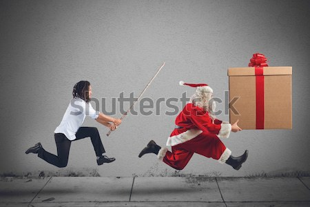 Angry child with Santa Claus Stock photo © alphaspirit