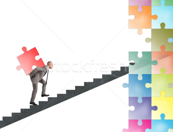 Missing piece of puzzle of a businessman build a new company Stock photo © alphaspirit