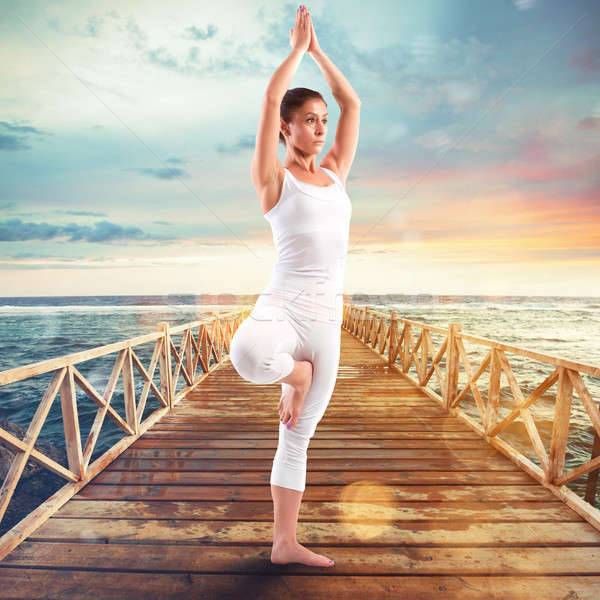 Exercises of gymnastics on a pier Stock photo © alphaspirit
