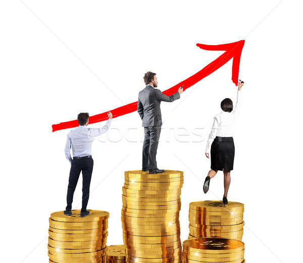 Business team draws growing arrow of company statistics over the piles of money Stock photo © alphaspirit