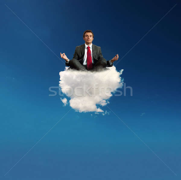 Stressed businessman practice yoga on a cloud Stock photo © alphaspirit