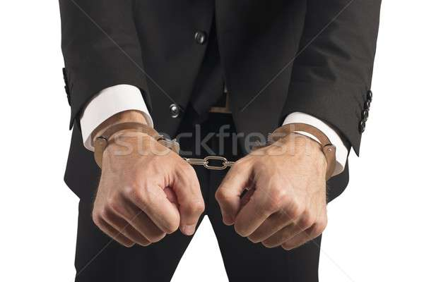 Businessman handcuffed Stock photo © alphaspirit