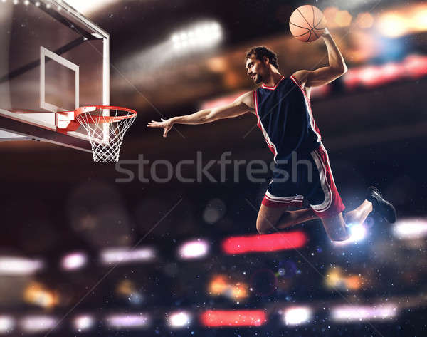 Basket player throws the ball at the stadium Stock photo © alphaspirit