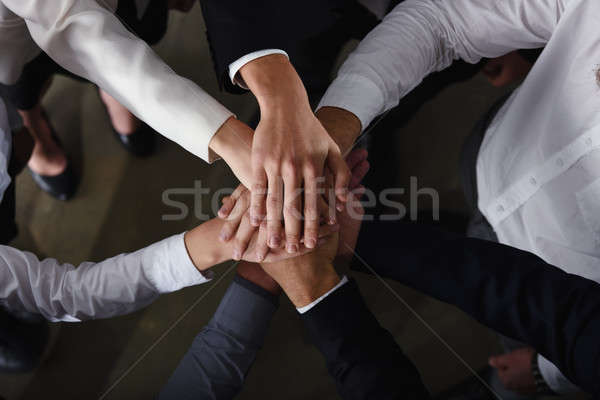 Business people joining hands in the office. concept of teamwork and partnership Stock photo © alphaspirit
