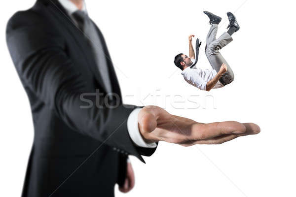 Businessman is saved from a big hand. Concept of business support and assistance Stock photo © alphaspirit