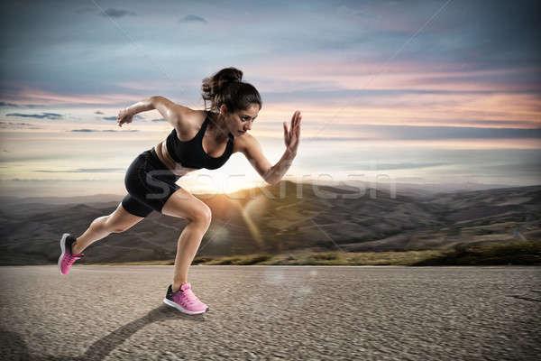 Athletic woman runs on the street during sunset Stock photo © alphaspirit