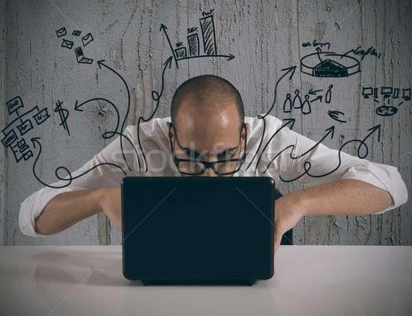 Businessman working with laptop Stock photo © alphaspirit