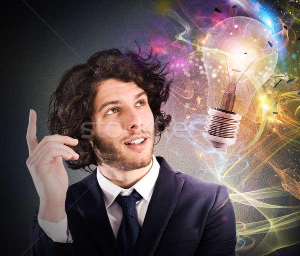 üzletember új kreatív ötlet néz villanykörte Stock fotó © alphaspirit