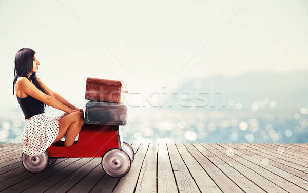 Girl ready to travel with a small car full of baggages Stock photo © alphaspirit