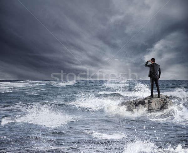 Om de afaceri uita viitor furtună mare economic Imagine de stoc © alphaspirit