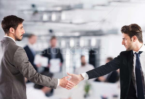 Business handshake. Concept of teamwork and partnership Stock photo © alphaspirit