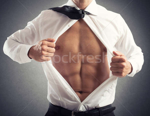 Businessman acts like a superhero. concept of bravery, determination and success Stock photo © alphaspirit