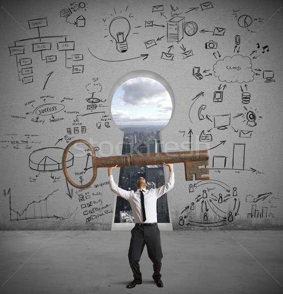 Businessman with the key to success Stock photo © alphaspirit