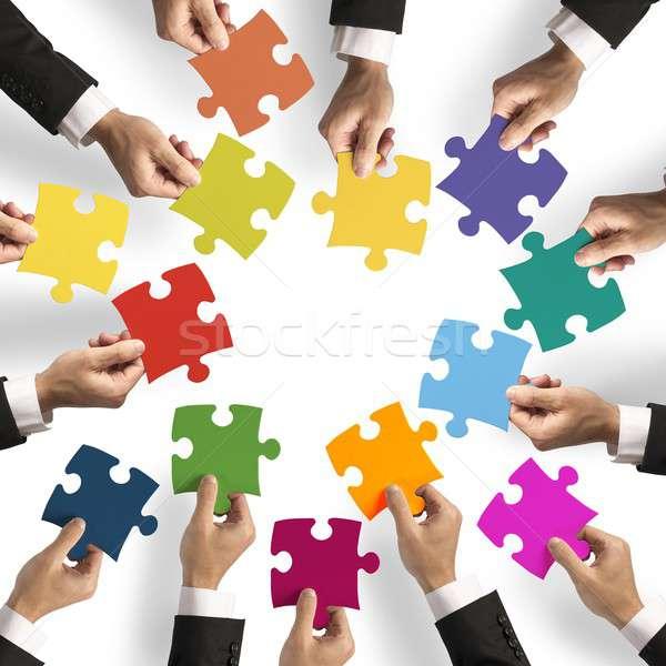 Teamwerk integratie puzzelstukjes business sleutel speelgoed Stockfoto © alphaspirit