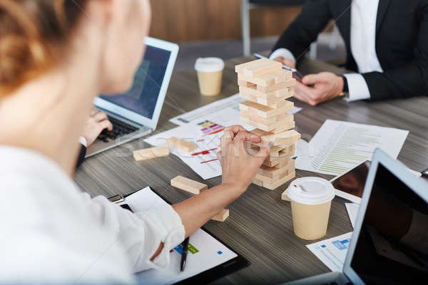 Team of business people build a wooden construction. concept of teamwork and partnership Stock photo © alphaspirit