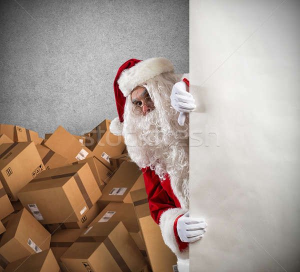 Santa Claus ready to deliver a lot of Christmas presents package Stock photo © alphaspirit