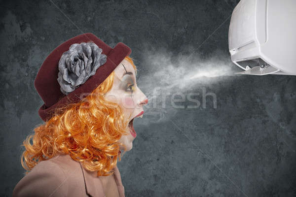 Clown amazed by the fresh of air conditioner Stock photo © alphaspirit