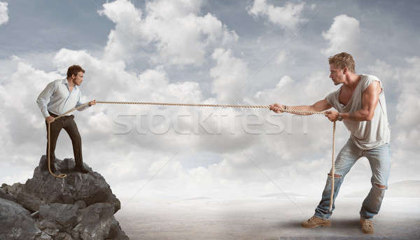 Határozott üzletember üzlet kő vállalati kötél Stock fotó © alphaspirit