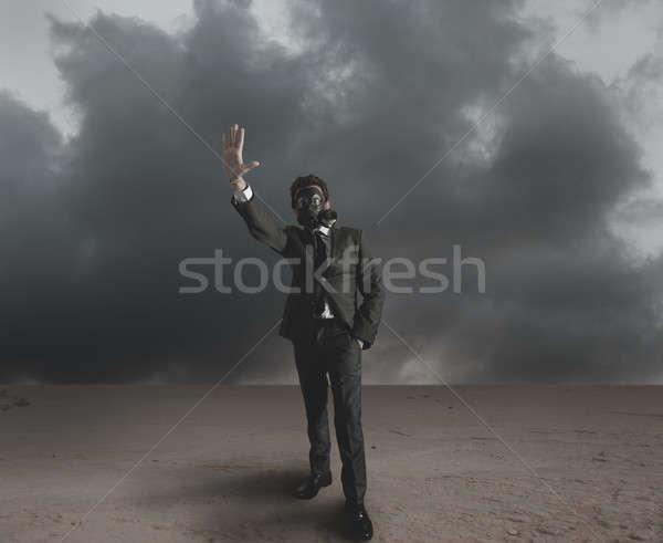 бизнесмен излучение опасность пустыне небе работу Сток-фото © alphaspirit