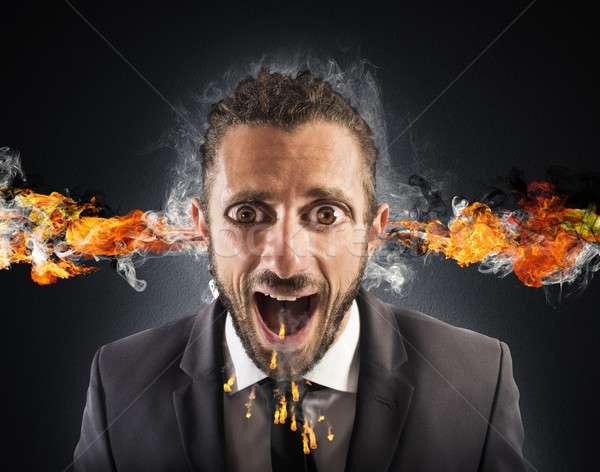 Stressed man spits fire Stock photo © alphaspirit