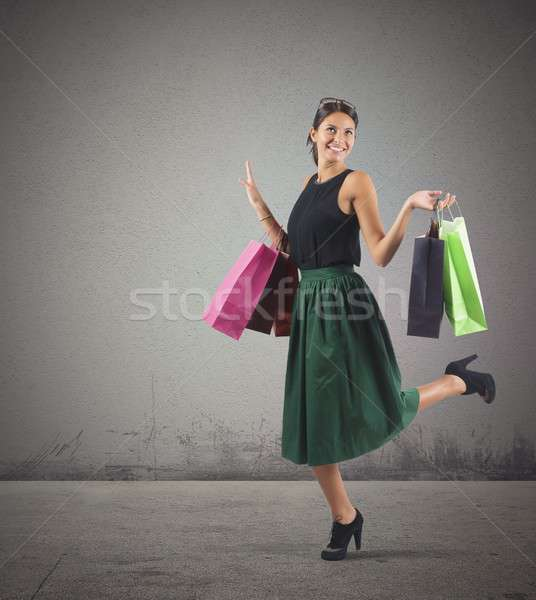 Shopaholic woman happy of her many purchases Stock photo © alphaspirit