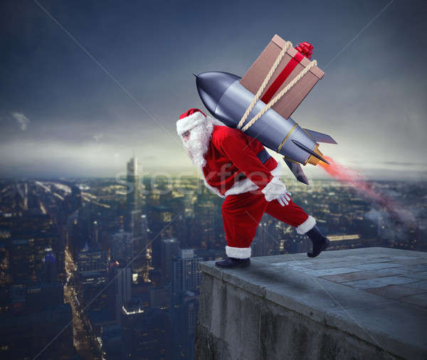 Fast delivery of Christmas gifts. Santa Claus ready to fly with a rocket Stock photo © alphaspirit