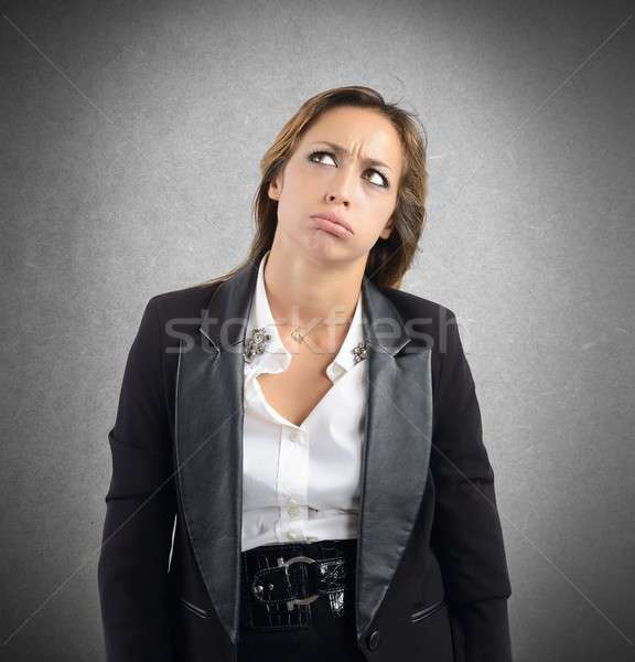 Businesswoman tired and bored by her work Stock photo © alphaspirit