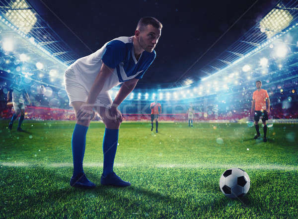 Soccer player ready to kick the soccerball at the stadium during the match Stock photo © alphaspirit