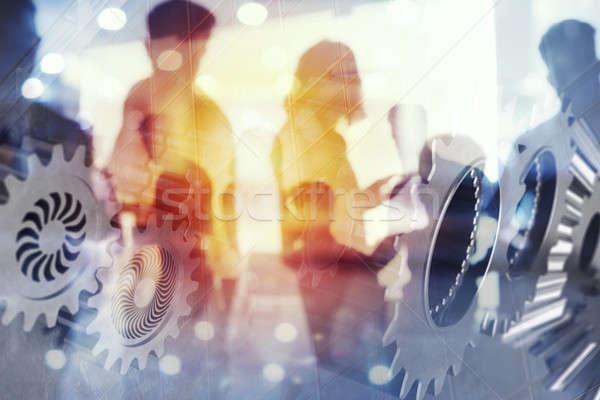 Gens d'affaires travaux ensemble bureau engins effets Photo stock © alphaspirit