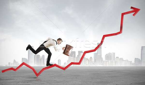 Businessman rises statistics Stock photo © alphaspirit