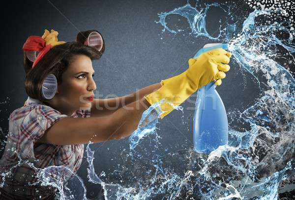 Housewife cleaning spray Stock photo © alphaspirit