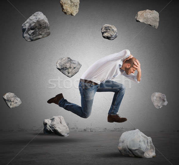 Businessman escapes from crisis Stock photo © alphaspirit