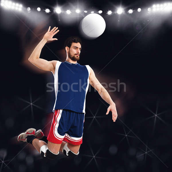 Volleyball player beats ball Stock photo © alphaspirit
