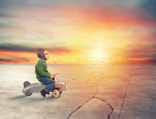 Kid plays with a small airplane during sunset Stock photo © alphaspirit