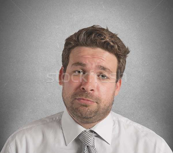 Businessman upset and stressed out from work Stock photo © alphaspirit