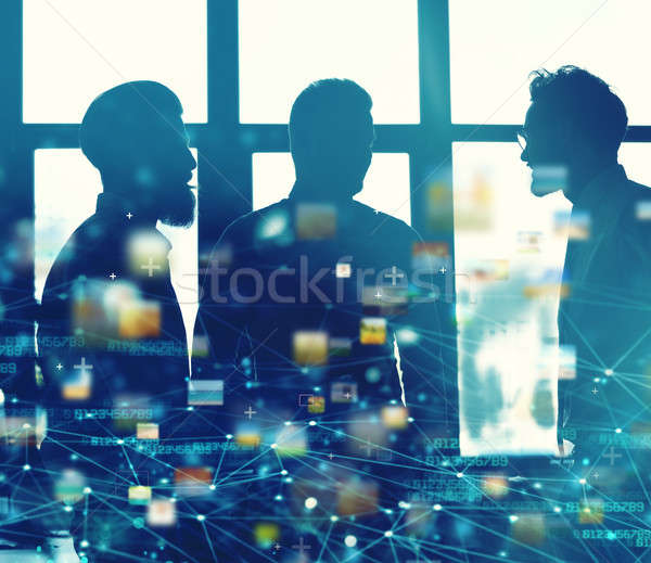 Businessmen that work together in office with network connection effect. Concept of teamwork and par Stock photo © alphaspirit