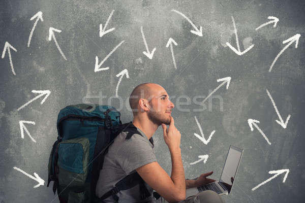 Explorer plans a new travel with his laptop Stock photo © alphaspirit