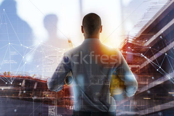 Businessman Architect analyzes the works of a building. double exposure Stock photo © alphaspirit