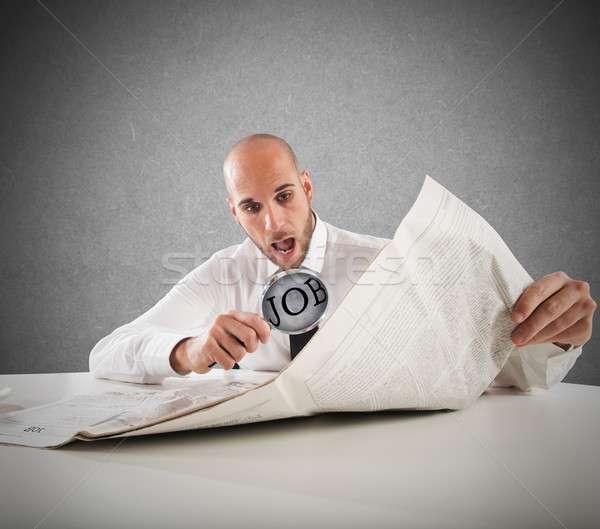 Váratlan állások üzletember olvas újság nagyító Stock fotó © alphaspirit