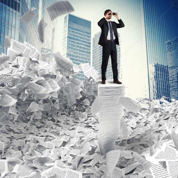 Empresário olhando futuro homem papelada Foto stock © alphaspirit