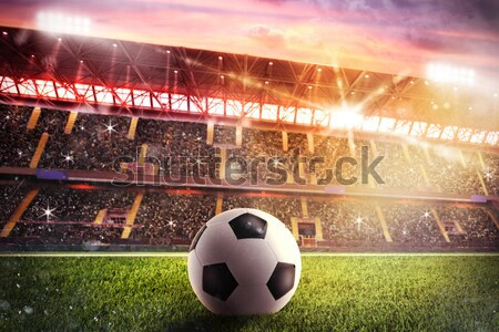 Soccerball at the stadium during sunset Stock photo © alphaspirit