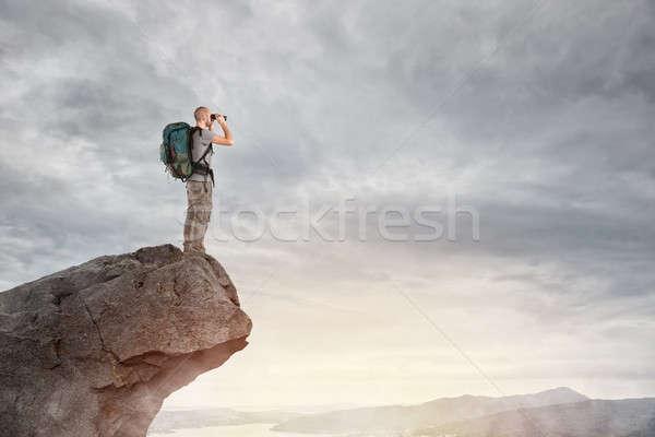 Explorer on the peak of a mountain Stock photo © alphaspirit